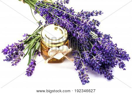 Lavender with aromatic oil isolated on white background.