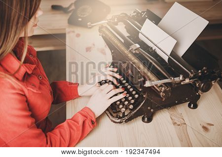 Young Woman Using Typewriter, Business Concepts, Retro Picture Style.