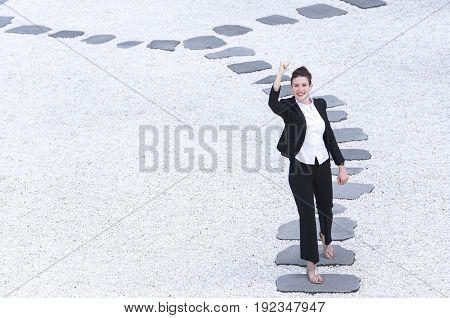 Modern Business Woman Raising Hand Walking On The Path