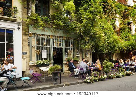 Paris France June 04 2017 : Famous style of life in Paris France with bistrrots and people on terraces. Here this is