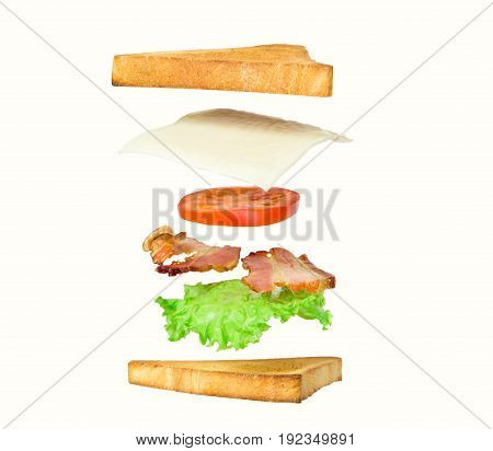 Fresh sandwich with flying ingredients isolated on white background. concept