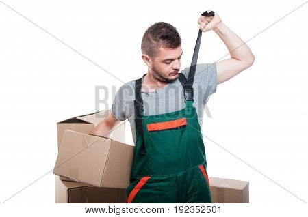 Handsome Mover Guy Holding Box Fixing His Overall