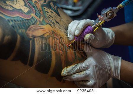 Tattoo Artist Drawing Art On Body