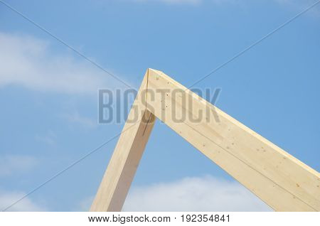 Huge wooden building joint for roof with sky behind