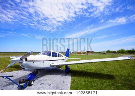 Small aircraft in the parking lot of the airfield.