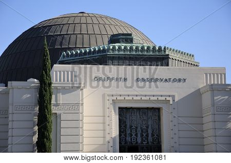The domed roof and front door at Griffitth observatory in Los Angeles California.