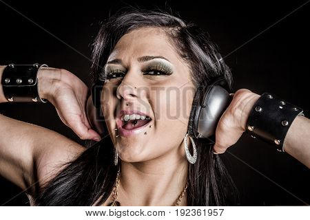 Beautiful singing woman wearing headphones