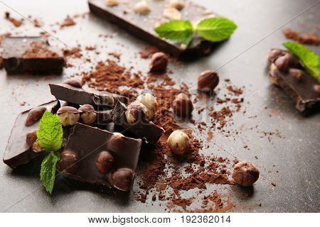 Broken chocolate pieces with mint on table