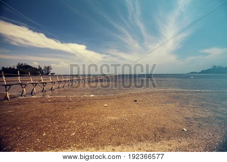 Remote tropical beach and blue sky on Phu Quoc island, Vietnam. Vintage effect.