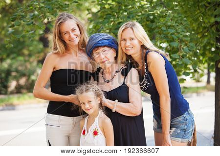 Generation. Old woman with granddaughter. Elderly female with family outdoors