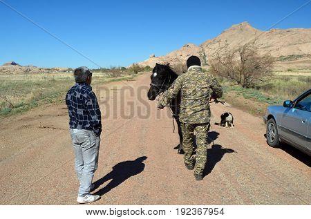 Bektau Ata national park ranger show the way to traveler..May 7, 2017.Bektau Ata.Kazakhstan