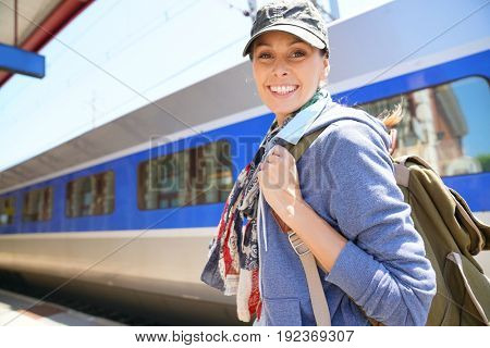 Backpacker girl waiting to get in the train