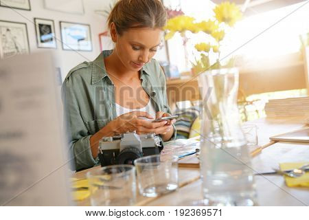 Young woman connected with smartphone at lunch time