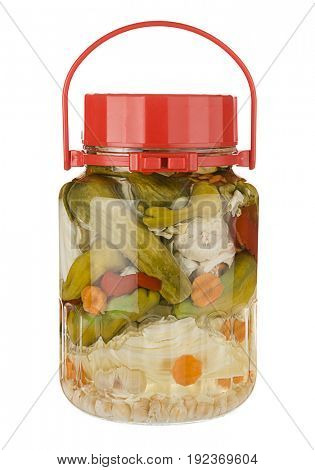 Glass Jar with variety of pickled vegetables inside isolated on white background.
