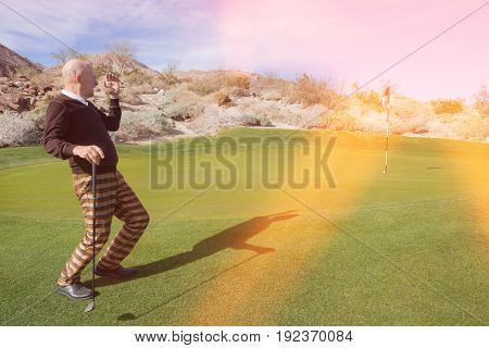 Full length of senior male golfer looking away at golf course