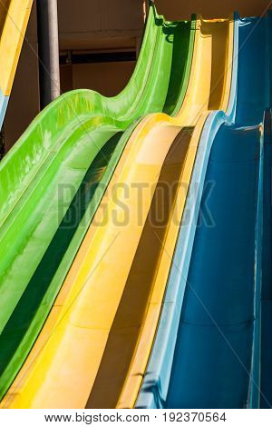 high empty colorful slider in water park background