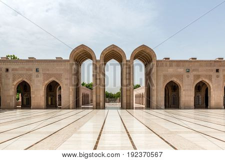 MUSCAT, OMAN - CIRCA AUGUST 2016: ITraditionally designed tall arched entry way with large empty courtyard