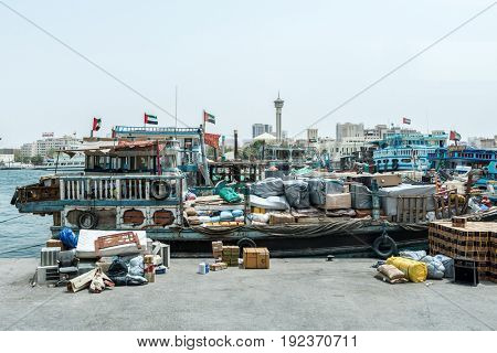 DUBAI, UAE - CIRCA AUGUST 2016:Traditional cargo boat loaded with goods moored in port for unloading