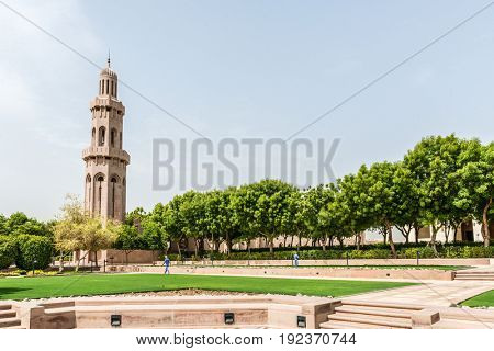 OMAN, MUSCAT - CIRCA AUGUST 2016: Minaret with green grass and park at the Grand Mosque of Muscat, Oman
