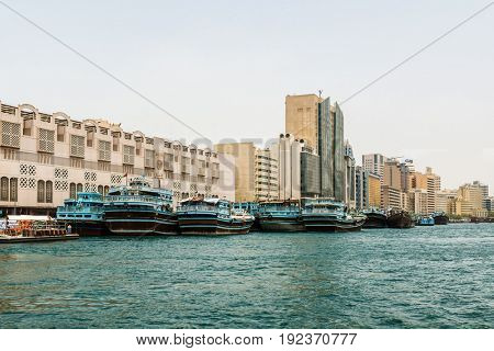 DUBAI, UAE - CIRCA AUGUST 2016: Water canal view of Arab city with several boats moored near traditional buildings - UAE