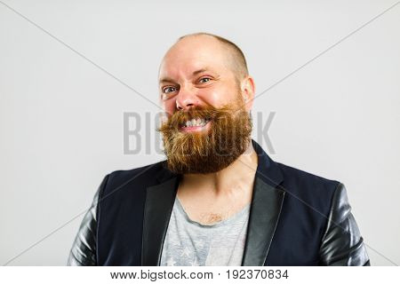 Laughing brutal man with beard