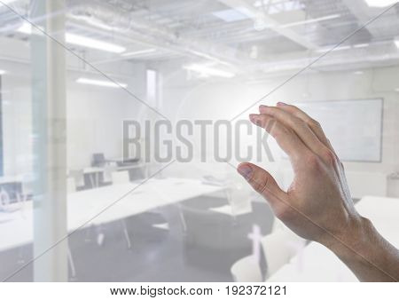 Digital composite of Hand touching air in classroom