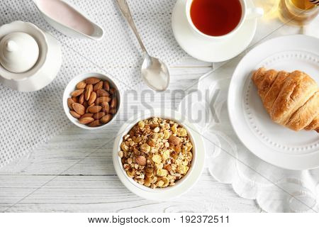 Healthy breakfast with muesli on table