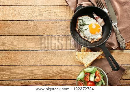 Delicious breakfast on wooden table