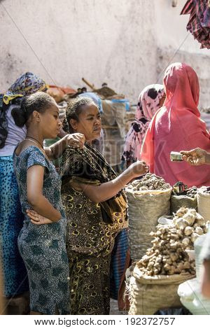 HARAR, ETHIOPIA-MARCH 31, 2017: Unidentified people buy and sell spices in Harar, Ethiopia