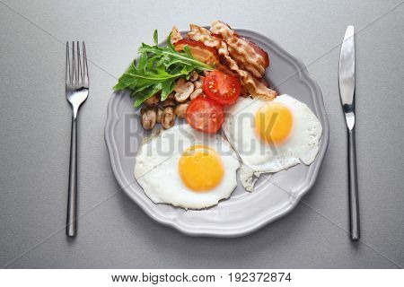 Tasty breakfast with eggs on plate