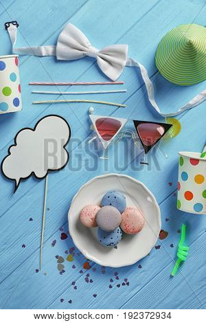 Party accessories on wooden background