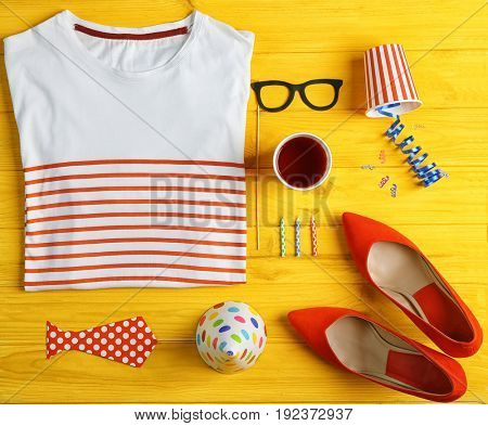 Party accessories on yellow wooden background