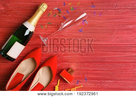 Party accessories on red wooden background