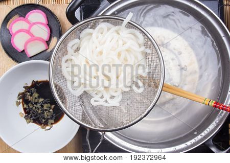Chef scald udon noodle in pot / Cooking Tempura Udon concept poster