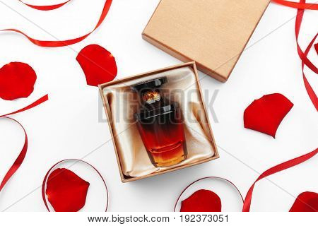 Perfume in present box on white background