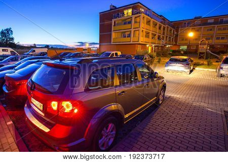 PRUSZCZ GDANSKI, POLAND - JUNE 7, 2017: Parking of modern residential apartments in Pruszcz Gdanski, Poland. Pruszcz Gdanski is growing industrial town neighbouring to Gdansk.