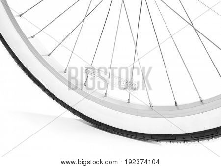 Wheel of modern bicycle on white background, closeup