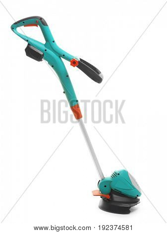 Modern grass trimmer on white background