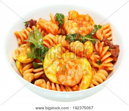 Shrimp and Fusilli Pasta with Summer Squash and Olives in round white bowl over white.