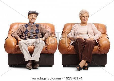 Seniors sitting in leather armchairs and looking at the camera isolated on white background