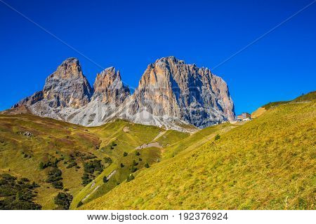The concept of extreme and ecological tourism. Travel to South Tirol. The famous Sella Pass in the Dolomites. Windy autumn day