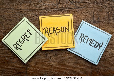 Regret, reason, remedy word abstract - handwriting on sticky note against rustic wood - crisis management concept