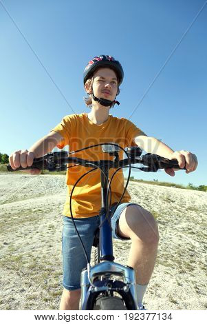 happy boy ride bikes outdoors
