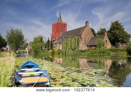 Restauration works on the church tower in Bleskensgraaf on the small river Graafstroom in the Dutch province South-Holland