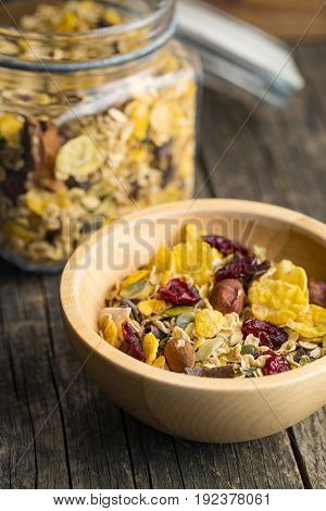 Tasty homemade muesli with nuts in bowl.