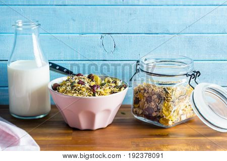 Tasty homemade muesli with nuts and milk.