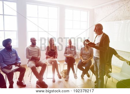 Student sitting in a class and teacher is teaching