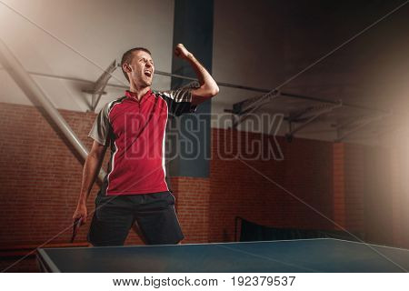 Male winner with racket, table tennis
