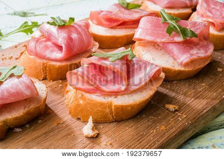 Bread with ham and greens