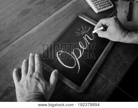 People Hand Writing Open on Chalk Board